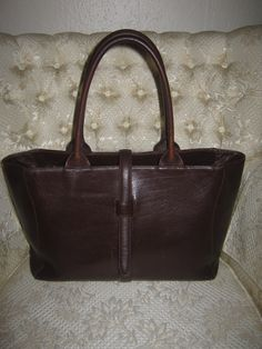 I just bought this Vintage Brown Genuine Leather tote on Etsy...