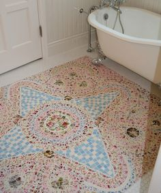 Knowing me, I would mosaic the entire floor to the wall but the simple white tile normal floor border is kind of interesting.