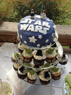 Have a simple tiered wedding cake and then geek it up with some Star Wars action figures on the lower tiers! Description from theidomoment.com. I searched for this on bing.com/images