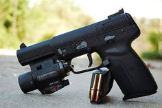 FN Five-seveN tactical. Awesome and amazing. It's super light but can penetrate a bullet proof vest. Blam!