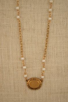 Freshwater pearl necklace with vintage pendant by ExVoto Vintage Jewelry.