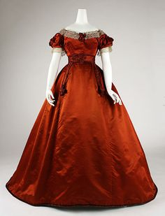 Dress, 1865-1868. I love the color combination - burnt orange, with a hint of ecru lace and black trim.