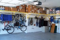 Wow!  Looks like a family sized collections of bikes is hanging on a fairly small wall...including a child trailer.