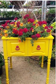 Planter made out of an old sewing machine cabinet. Love this.