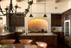 Cabinets and lighting with center island and bar