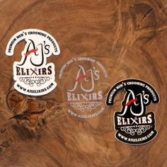 """AJ's Elixirs Grooming Products 3"""" logo vinyl stickers available in white, black, and clear."""