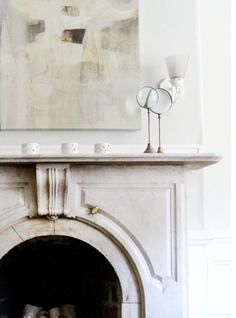 The Impact of Art - love the neutral colors and beautiful mantle