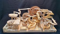 Seven Amazing Wooden Marble Machines by Paul Grundbacher A Wooden Marble Machine Uses Gears and Lifts to Endlessly Push Marbles Down 3 Separate Tracks Wooden Marble Run, Marble Toys, Marble Maze, Rolling Ball Sculpture, Marble Tracks, Kinder In Not, Marble Machine, Wooden Gears, Drawing Machine
