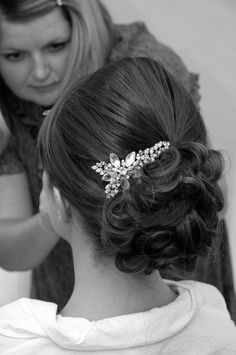 Kelly Spence Accessories. Wedding hair up-do - love the jewel in this.