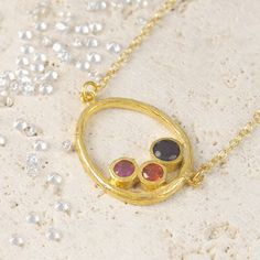 An abstract oval design with hand-set semi-precious faceted stones - this piece defines the Embers ethos - historical references with a modern aesthetic. #Embersjewellery #Jewellery #July #Birthstone #Ruby