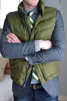 Green tie, down vest.