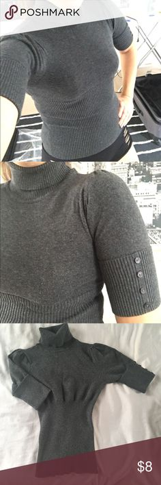 Classy Turtle Neck Charcoal grey turtle neck. 1/4 sleeves with button details as shown in pic. Fold over turtle neck. Stretchy and fitted waist for comfort and fit. Bit of a rouched puffy shoulder as seen in pics.Excellent used condition. Size small. Tops