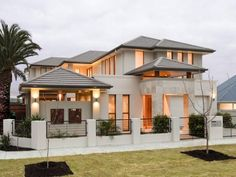 Concrete modern house exterior with bay windows & decorative lighting - House Facade photo 217630
