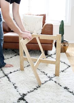 Intermediate woodworking skills needed to create a collapsable plywood table that's minimal in design and easy to store.