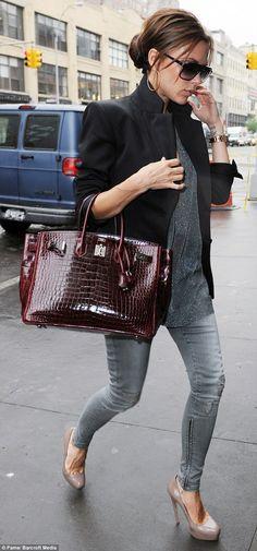 PETA is calling on Mrs Beckham, pictured in 2010 with a crocodile skin Hermès Birkin bag, ...