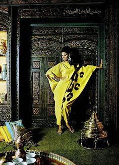 Model is wearing a silk caftan by Donald Brooks, photo by Howell Conant at the Kuwait embassy, 1966