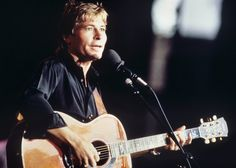 John Denver..love his soft, gentle voice and harmony...know most of the words to all of his songs :D