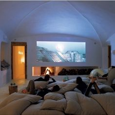 Movie Room full of pillows instead of buying a couch