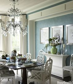 "Designer Gary McBournie opted for lighter, muted colors in this Palm Beach house rather than the eye-catching bright colors that are the norm in the area. ""We wanted to keep it light and clean, so we used watery blues, silvery taupes, sun-bleach pinks, greens, and lilacs,"" he says. ""I wanted to give it the mood of being away, someplace else. It feels a little like Italy or the Caribbean."" Everything white, including a sideboard from Lars Bolander and vintage Chinese Chippendale chairs…"