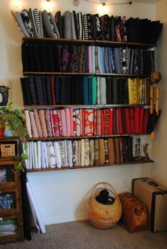 Inspiring open fabric storage using comic book boards! from Sew I Thought…