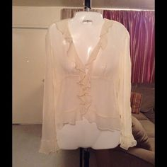 """Ralph Lauren 100% Silk Top Ralph Lauren Top is made of 100% Silk. This Top is see through. Long sleeve. Size 6 Petite. 5 Button closure. The color is Tan or Beige.  The Arm Length is """"19. Laying flat """"17. Length of Top """"22.5. This item is NOT new, It is used and in Good condition. Authentic and from a Smoke And Pet free home. All Offers through the offer button ONLY.  Ask any questions BEFORE purchase. Please use the Offer button, I WILL NOT negotiate in the comment section. Thank You Ralph…"""