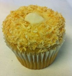 Our October cupcake of the month is… the Coconut Cream Cupcake, with a smooth coconut centre and a swirl of decadent frosting and toasted coconut on top.