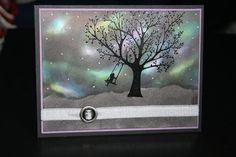 Stamp Inspirations: Northern Lights--It is a sponging technique where you blend lots of bright colors followed by adding navy and black for depth. These colors make the bright ones pop, resembling the dancing Northern Lights. I embossed the tree (from the Forever Young set) with black embossing powder to really give it some life against the dark background. I am really happy with how it stands out. The last touch in the sky was to use my white gel pen to add tiny dots for stars. I added so