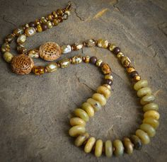 """Barrel shaped jasper, hand-carved jade, wood beads and center drilled natural jade. Necklace is approximately 30"""" in length and is one of a kind."""