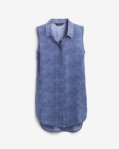 "An airy take on a denim staple, this sleeveless tunic is super lightweight for balmy days. We designed this woven style with a classic back pleat and deep side vents for a comfortable fit. Our favorite pairing right now is this shirt with slim crop pants and our studded sandals.    Sleeveless denim print tunic shirt   Polyester. Machine wash, cold.   Regular: Approx. 31"" from shoulder   Petite: Approx. 29"" from shoulder   Imported"