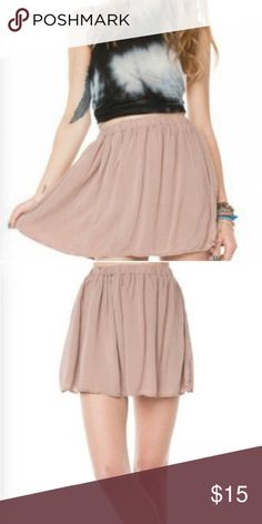 Brandy Melville Pink Blush Luma Skirt Perfect light material for a summer staple. Pair with a white crop and converse for a relaxed day outfit, or a black crop and booties for a look to kill the night. For those that are unfamiliar with the brand, it is a one size fits most item. Brandy Melville Skirts