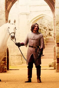 A beautiful Gwaine with a beautiful horse. - it's Flynn and Maximus(I think that was the horse's name)