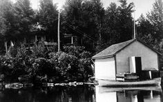 The original view of the property from the lake with the old boathouse, which is no longer standing.
