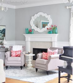 spring living room @Centsational Girl So much to love about this: grey walls, white trim, turquoise vases w/ pink tulips, arm chairs in front of the fireplace...love.