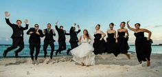 Coolest beach wedding picture of the bridal party!!!