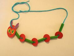 Eric Carle - Very Hungry Caterpillar necklace craft - green-dyed pasta, yarn, paper scraps