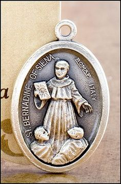 Blessed By Pope Francis St. Bernardine of Siena Patron of Those Who Suffer From Respiratory Ailments Pray for Us Medal Silver Oxidized. Pray for us - Italy in back of the medal - size - about 3/4 of an inch. Blessed by Pope Francis. Silver Oxidized Saints Medals come on a convenient jump ring, ready for a stainless steel chain. -- Silvertone. Made in Italy, this medal will never rust. Beautiful keepsake for years to keep.