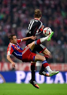 MUNICH, GERMANY - DECEMBER 06: Rafinha of Bayern Muenchen and Stephan Kiessling of Bayer Leverkusen compete for the ball during the Bundesliga match between FC Bayern Muenchen and Bayer 04 Leverkusen at the Allianz Arena on December 6, 2014 in Munich, Germany. (Photo by Matthias Hangst/Bongarts/Getty Images)
