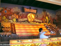 Disney's California Adventure's boardwalk games in newly reopened Paradise Pier have classic games of skill and chance. Take a look at the Disney themed boardwalk games you can play for chance to win a prize. http://land.allears.net/blogs/lauragilbreath/2009/08/ready_disneys_california_adven_1.html | #ParadisePier #BoardwalkGames #Goofy #Mickey #Minnie #DonalDuck #Daisy #Pluto #CaliforniaAdventure #DisneyParks