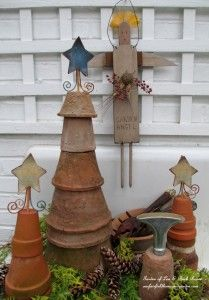 Flower Pot Trees http://ourfairfieldhomeandgarden.com/winter-decorating-at-our-fairfield-home-garden/