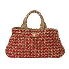 Add Style and Sophistication to your look wearing this fun and chic Prada red and honey raffia tote bag. Features double rolled handles. Int...