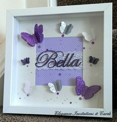 """Beautiful handmade 3D butterfly frame, can be personalised with a name of your choice and is also available in various other colours. Each butterfly is hand cut from a hand drawn template which makes them completely unique! The name is cut using a paper cut technique which allows me to add any name. Frame measures 25 x 25cm (9"""" x 9"""")"""