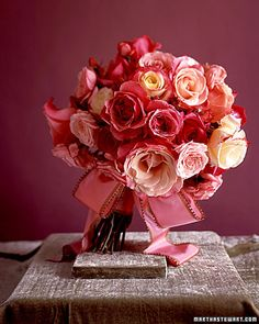Garden Roses    This fragrant bundle puts the classic garden rose on display. Wide pink ribbon edged in brown blends seamlessly with this bouquet.