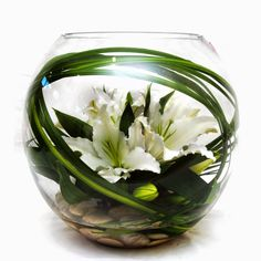 Pure Delight - our bestselling fishbowl arrangement of oriental lilies displayed with elegant foliage, smooth river pebbles and spear grass. Vase Arrangements, Wedding Flower Arrangements, Flower Centerpieces, Wedding Centerpieces, Wedding Flowers, Centrepieces, Arte Floral, Deco Floral, Ikebana