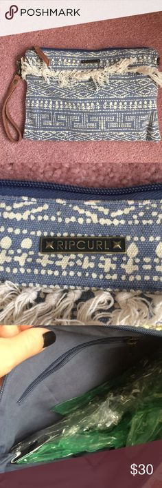RipCurl clutch NEW! This clutch is new even though tags have been removed. I am looking for a reasonable offer! Rip Curl Bags Clutches & Wristlets