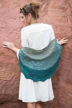 This shawl uses separate floral motifs for each color of yarn. Go gradient as shown, or go wild with three contrasting colors! By Anne Podlesak. Size 5 needles.