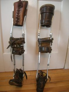 "Vintage Leg Braces Polio Medical Device. This is a pair of leg braces made from leather and aluminum probably from the 1930s. They are in great condition for their age, the leather is not rotten and the metal is unscathed. They stand 28"" tall and are 7"" at the widest point. The shoes measure 9"" from tip to heel."