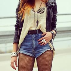 black leather jacket, spiked bra, high-waisted shorts, risky fish nets, cross necklace, arm candy, rings