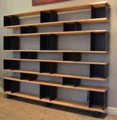 Impressive Shelving Unit in the Style of Charlotte Perriand   From a unique collection of antique and modern shelves at https://www.1stdibs.com/furniture/storage-case-pieces/shelves/