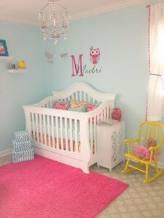 I love this nursery! I love the colors used, and there are so many great ideas here!! the only one thing I don't like in this room is the wall decal above the crib.