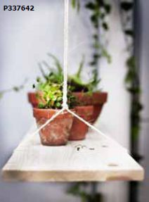 Like the idea of a DIY hanging shelf.... maybe in front of a window with screw in hooks, string and a board.